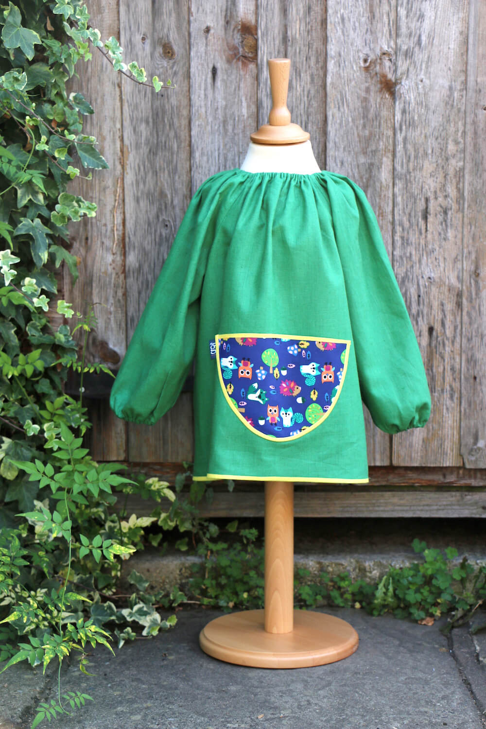 Traditional children's green linen smock, Forest Friends pocket