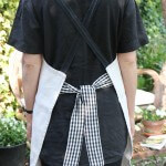 Natural linen apron with gingham ties, back