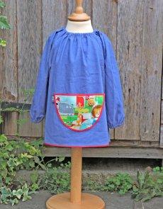 Traditional children's blue linen smock, Jungle Fever pocket