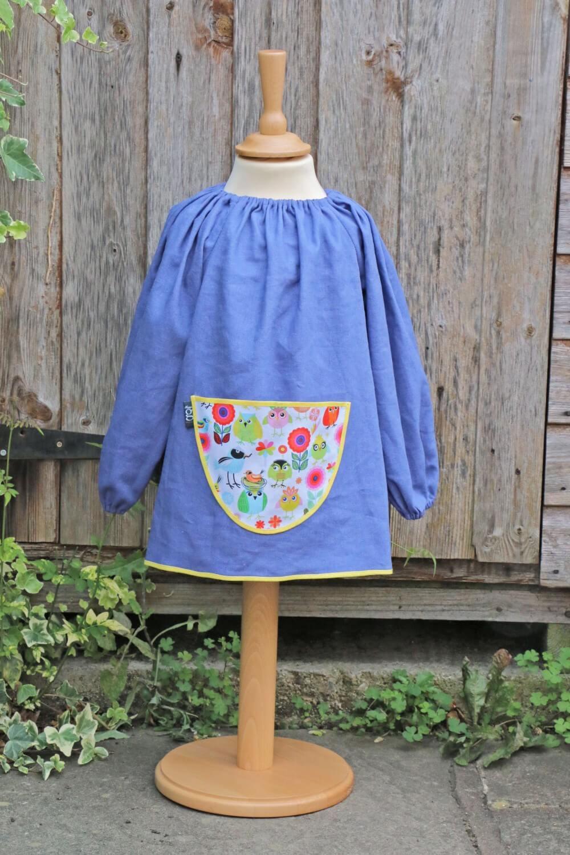 Traditional children's blue linen smock, Tweet pocket