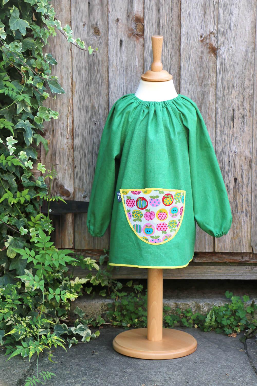 Traditional children's green linen smock, Apples pocket
