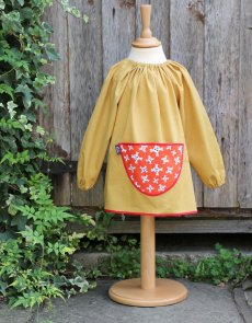 Traditional children's mustard linen smock, Pirates pocket