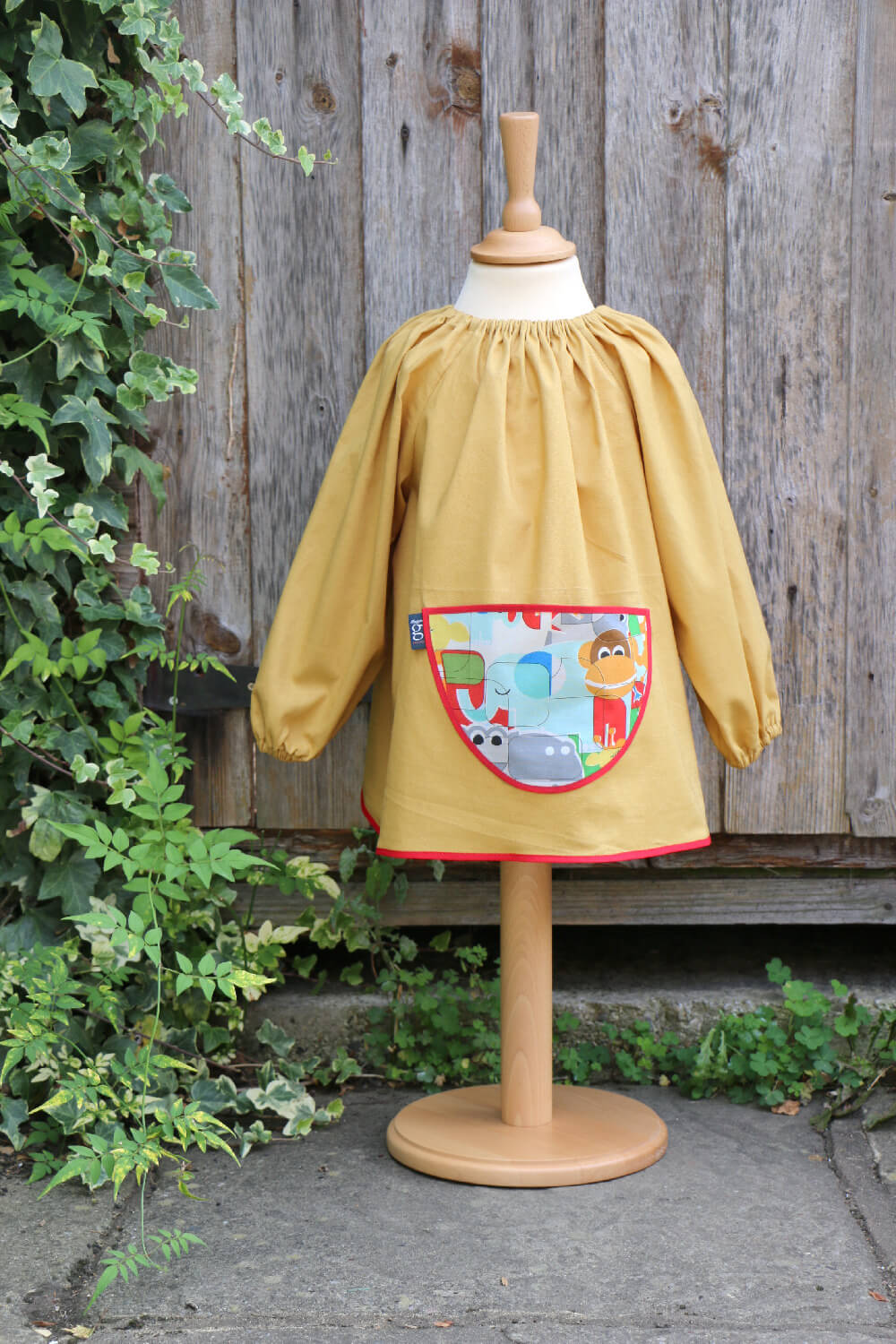 Traditional children's mustard linen smock, Jungle Fever pocket