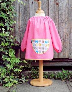 Traditional children's pink linen smock, butterflies pocket