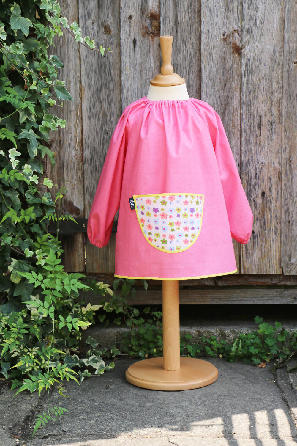 Traditional children's pink linen smock, Flower Power pocket
