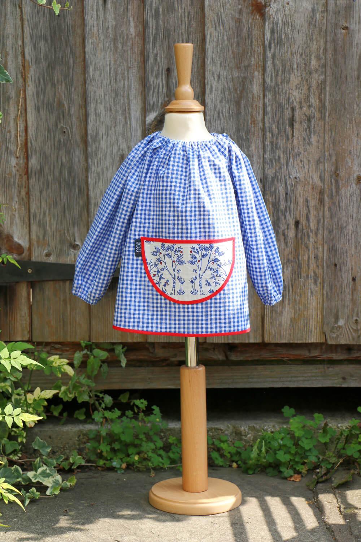 Traditional children's blue gingham smock, Trees pocket