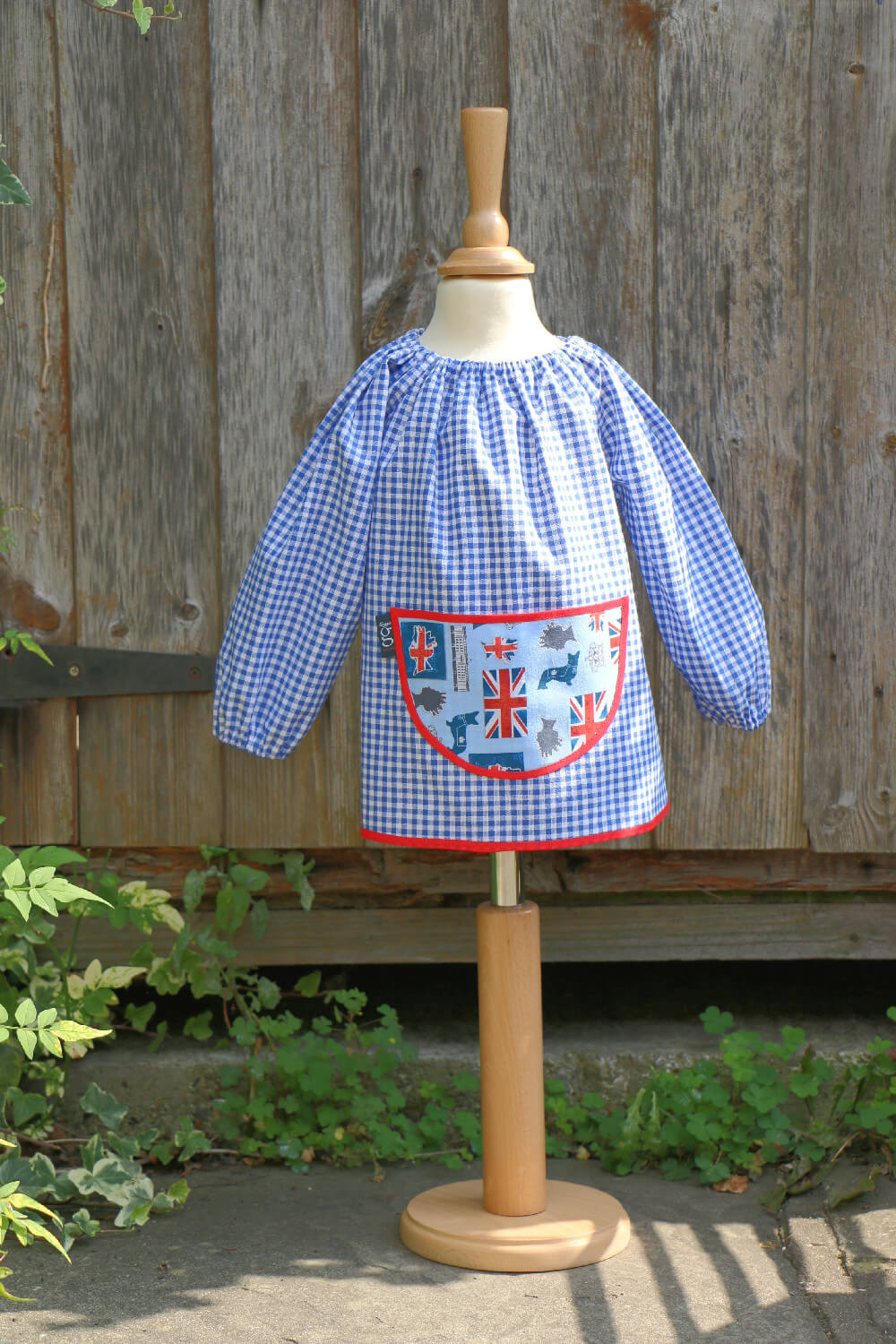 Traditional children's blue gingham smock, Britannia pocket