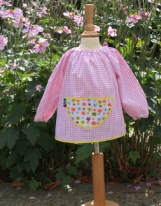 Traditional children's pink gingham smock, Flower Power pocket