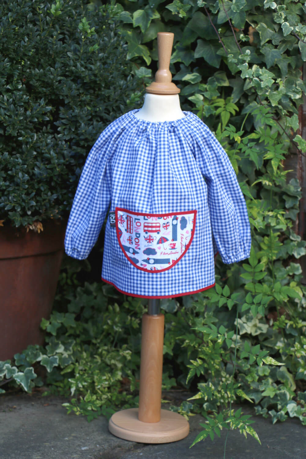 Traditional children's blue gingham smock, Pink London pocket