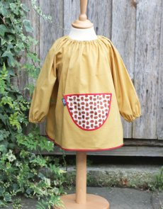 Traditional children's mustard linen smock, Hedgehog pocket
