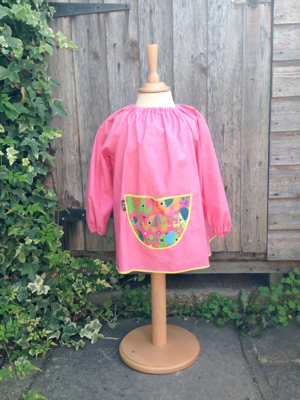 Traditional children's pink linen smock, Elephants pocket