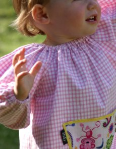 Traditional children's pink gingham smock, Cheeky Monkey pocket