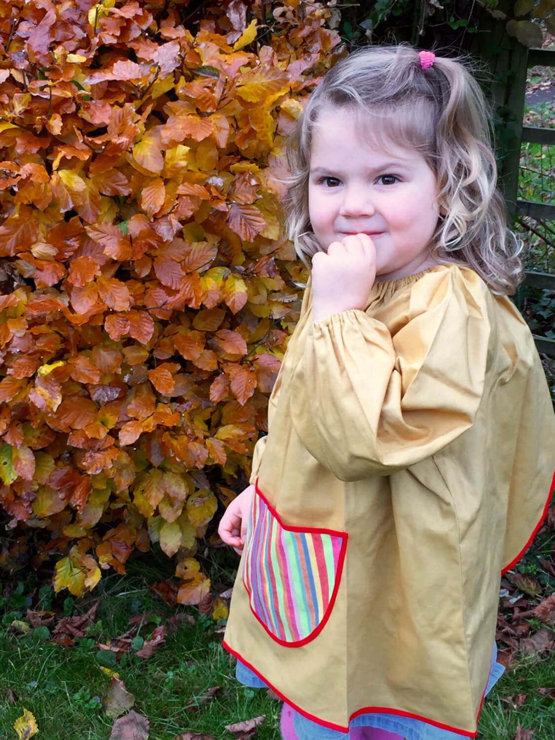 Traditional children's mustard linen smock, Stripes pocket