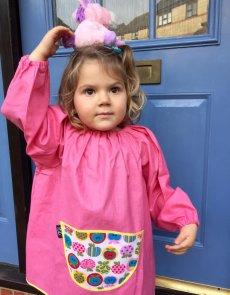 Traditional children's pink linen smock, Apples pocket